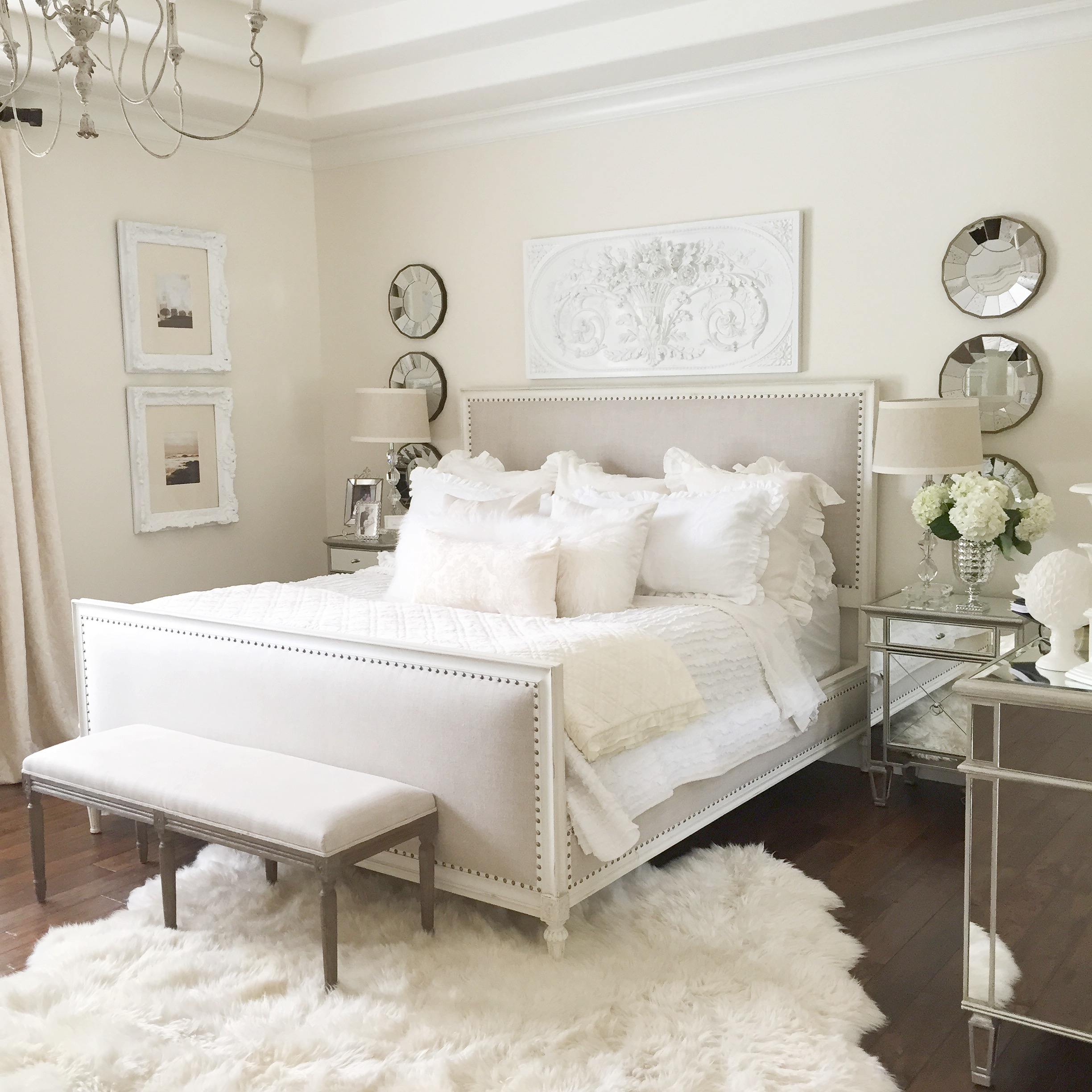 bedroom with restoration hardware bed white wall mirrored furniture