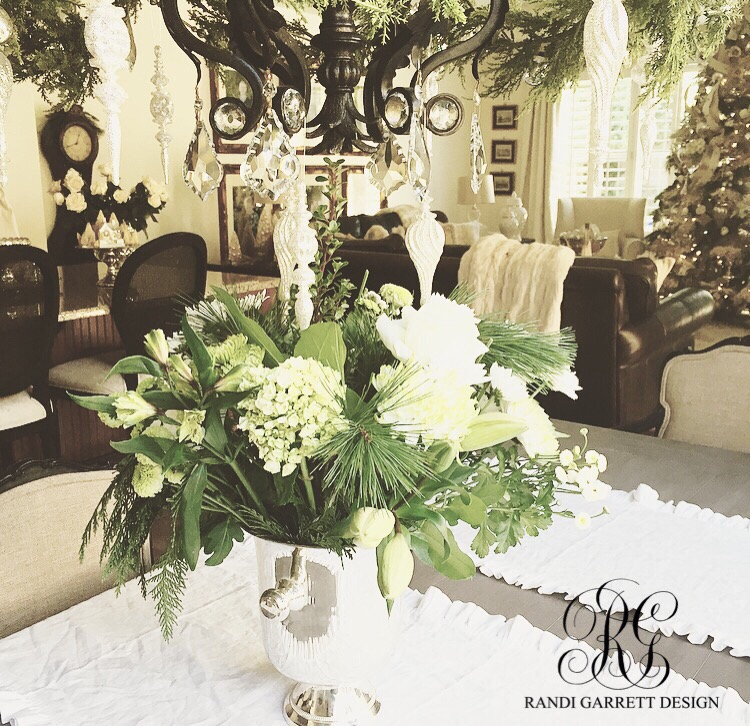 Christmas floral arrangement centerpiece with white hydrangea , roses and lilies