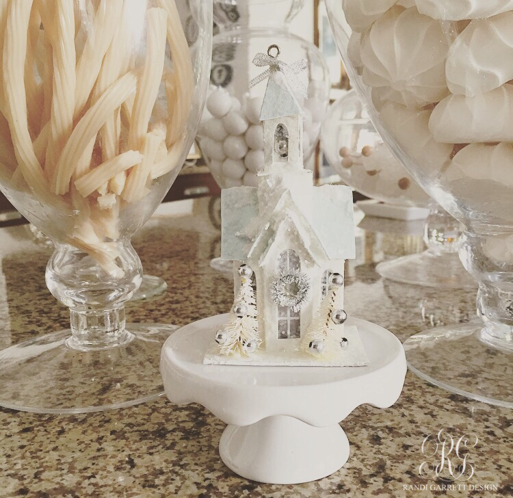 Vintage mini church on a mini cake stand white candy in jars