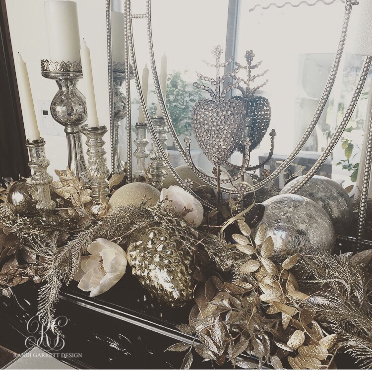 Silver and gold Christmas tablescape with mercury glass candle sticks and onraments