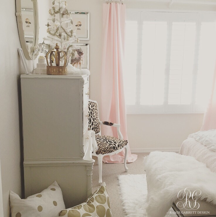 Pink and gold girls room with leopard and white fur, table top feather wreath