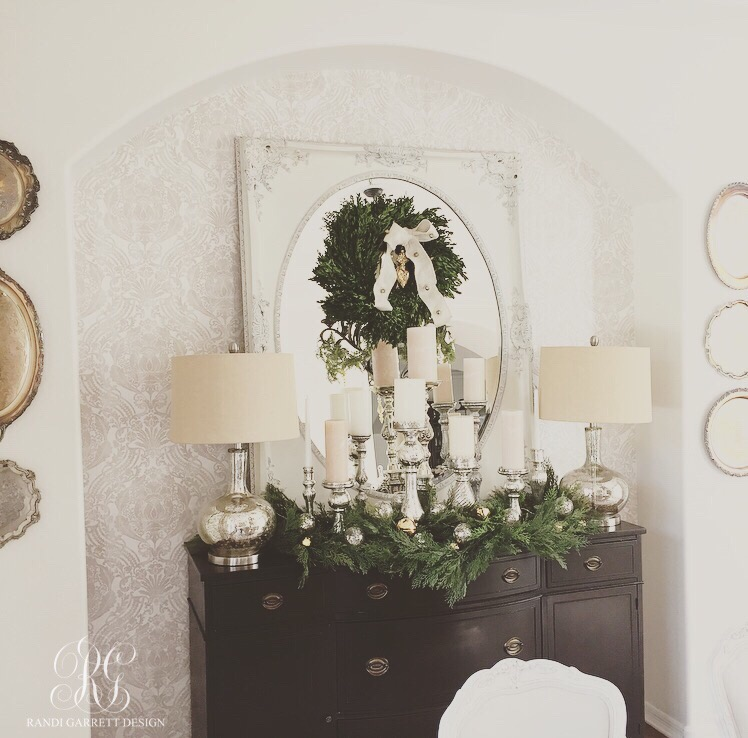Elegant Christmas dining room using fresh boxwood and faux garland and mercury glass candles