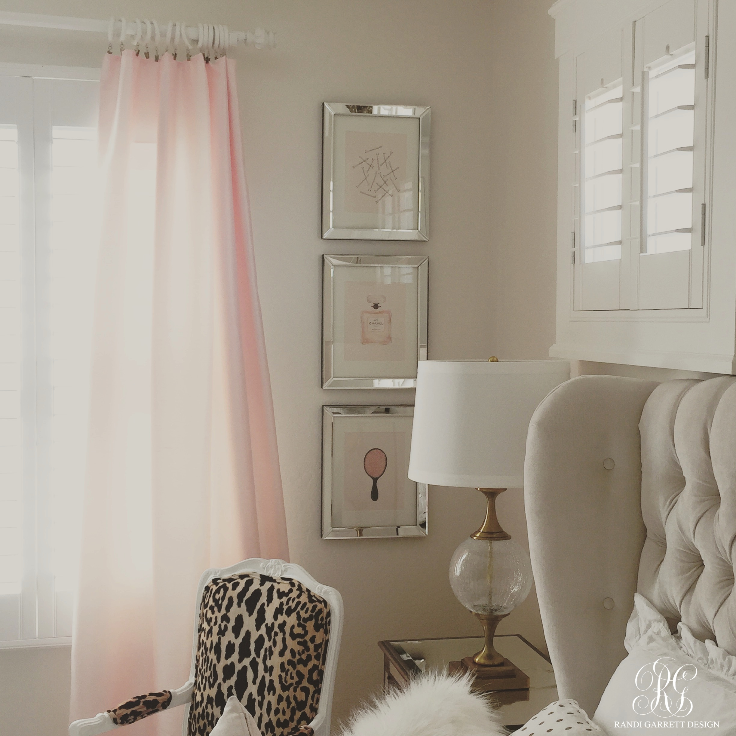 Pink and gold bedroom by Randi Garrett Design with mirror framed frames