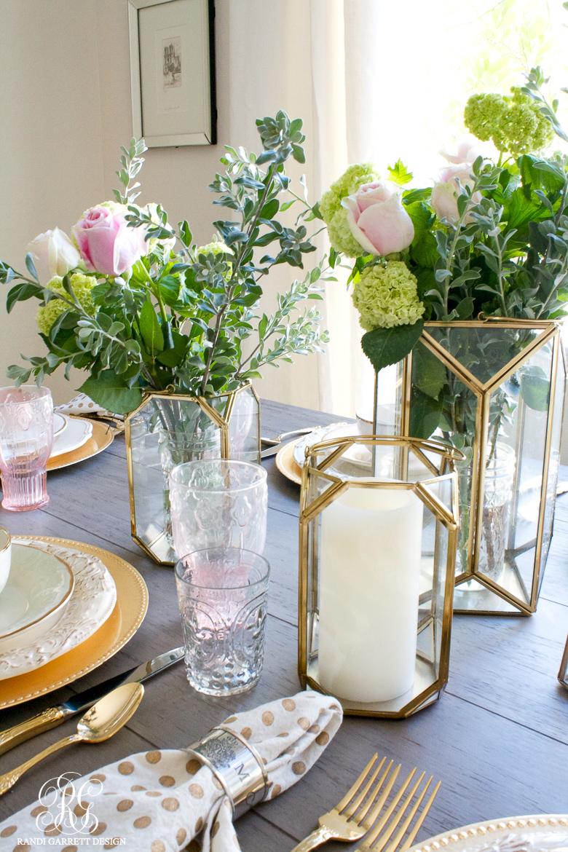 Floral arrangement with gold lanterns by Randi Garrett Design