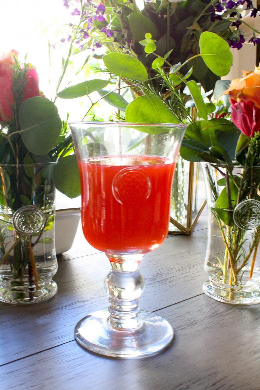 Skyros Designs Eternity Glass Goblets with peach raspberry lemonade