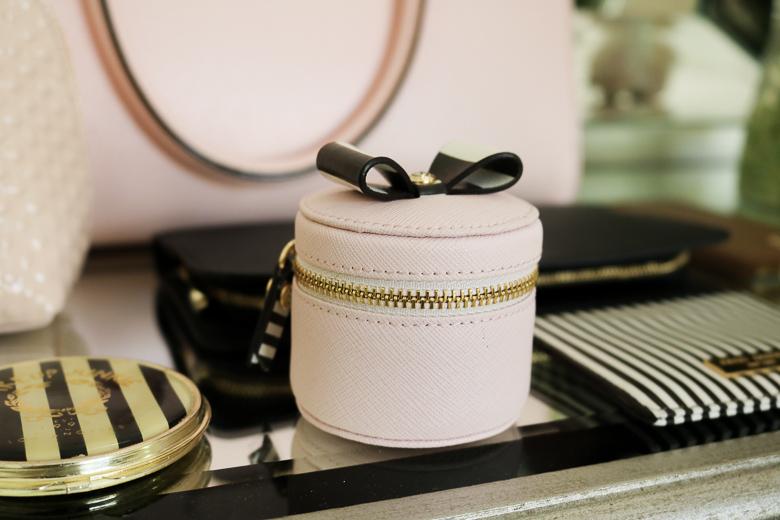 Pink Henri Bendel ring case, used for earphones
