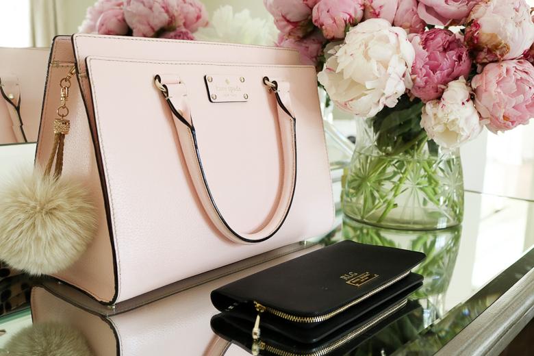 Pink Kate Spade purse, black Henri Bendel wallet