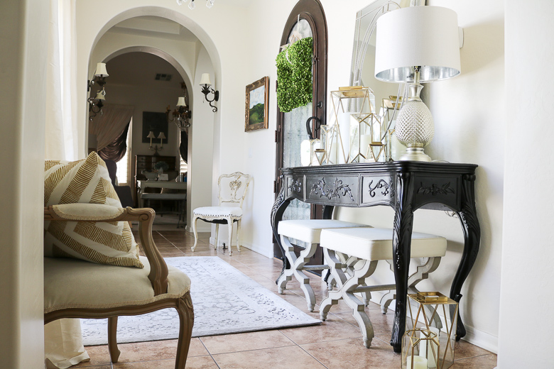 gold lantern collection in summer entryway