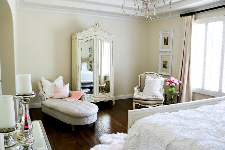 Pops of pink in romantic master bedroom for summer