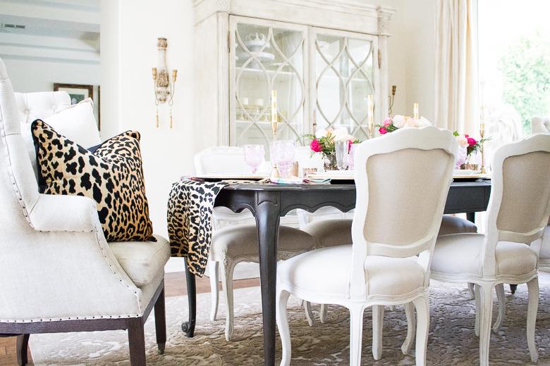 Elegant dining room with leopard pillow by Randi Garrett Design