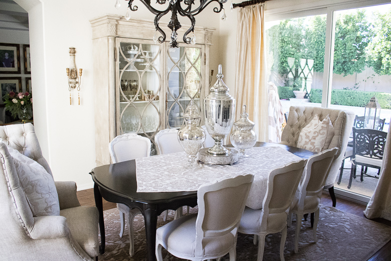 Elegant Dining Room With White Chairs