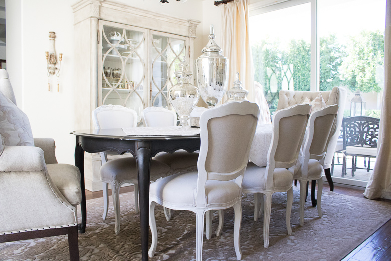Elegant White Dining Chairs In Neutral Dining Room