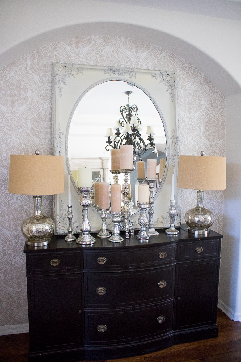 Mercury glass candle sticks on dining room buffet
