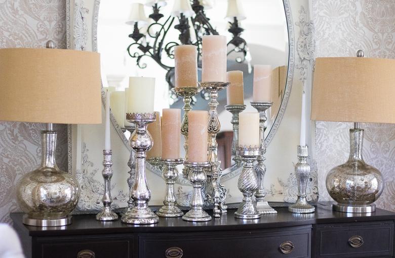 Mercury glass candles sticks on dining room buffet
