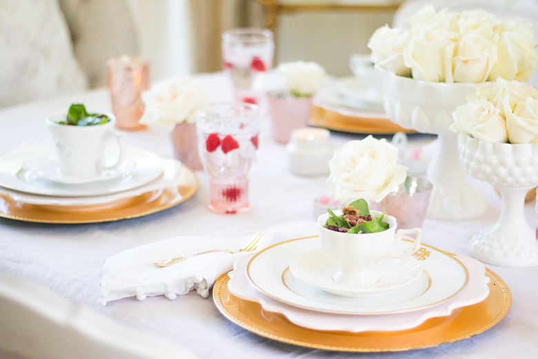 Pink and gold tablescape with salads in teacups