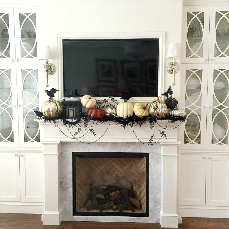 halloween-mantle-with-black-feathers-and-mercury-glass