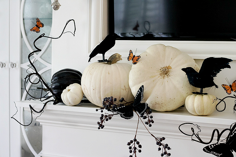 black-and-white-halloween-mantle-with-orange-and-black-butterflies