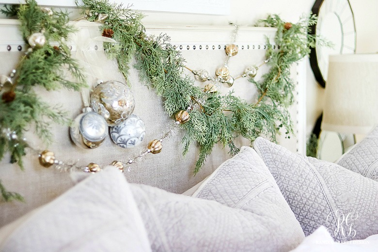 deck-the-halls-christmas-home-tour-garland-on-headboard