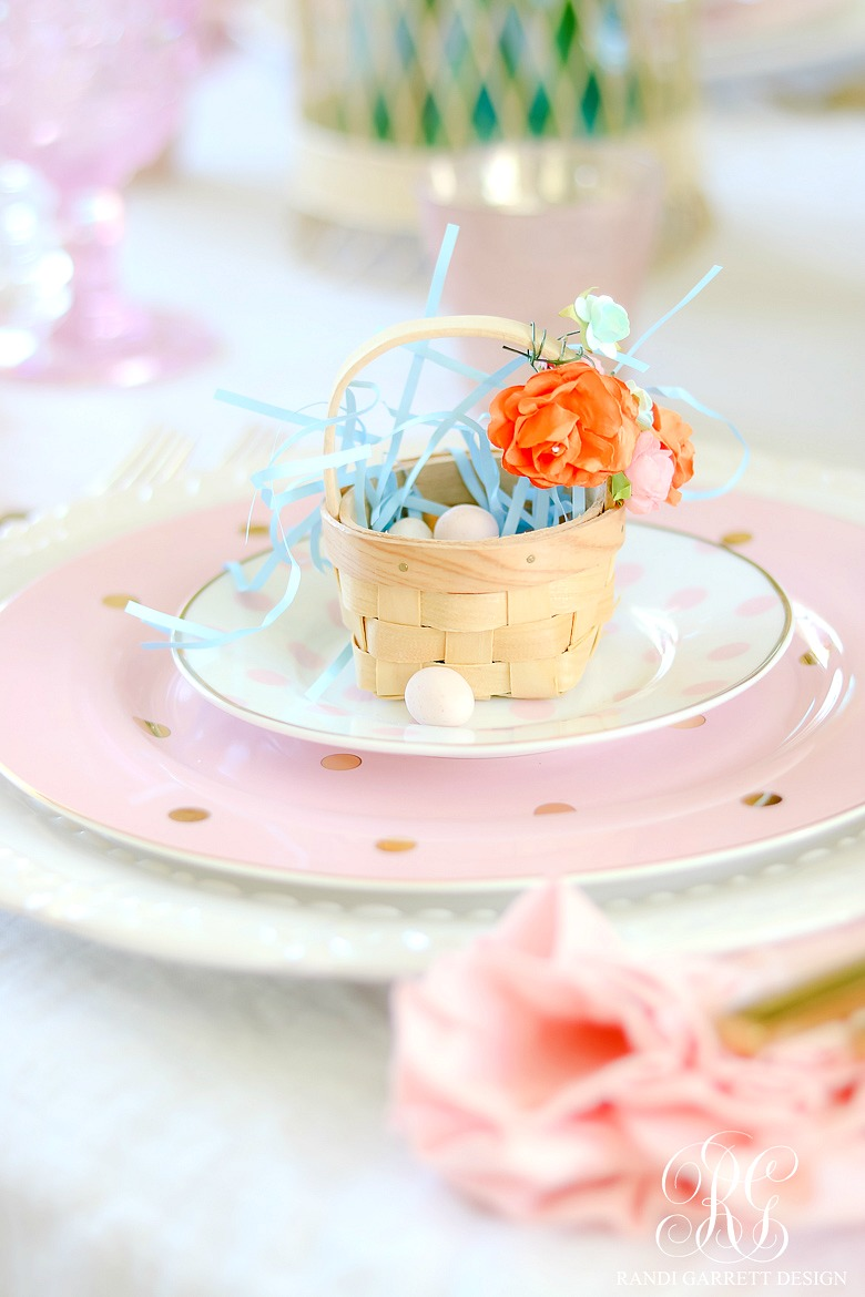 How to set a perfect pink easter table with diy mini floral easter if you dont have mini easter baskets laying around like me use any color easter grass and a few chocolate eggs to create a sweet nest for your place negle Image collections