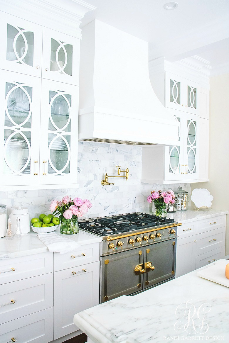 Girlfriend's Guide to Marble Countertops -white kitchen with marble countertops
