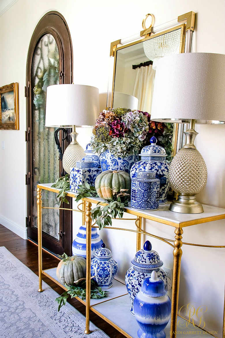 blue and white ginger jars styled for fall - fall entry table