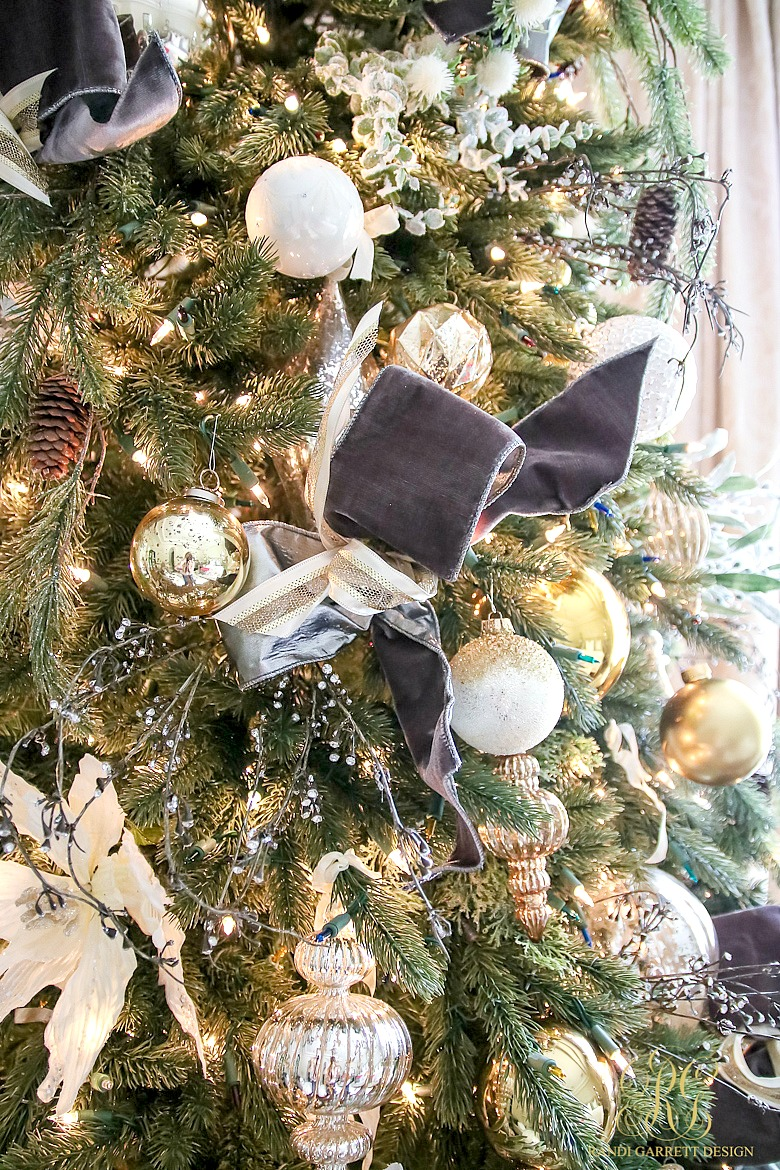 you can create tufts of ribbon by looping a few strands together with wire they will look like bows tuck them into the tree - How To Decorate A Christmas Tree Like A Professional