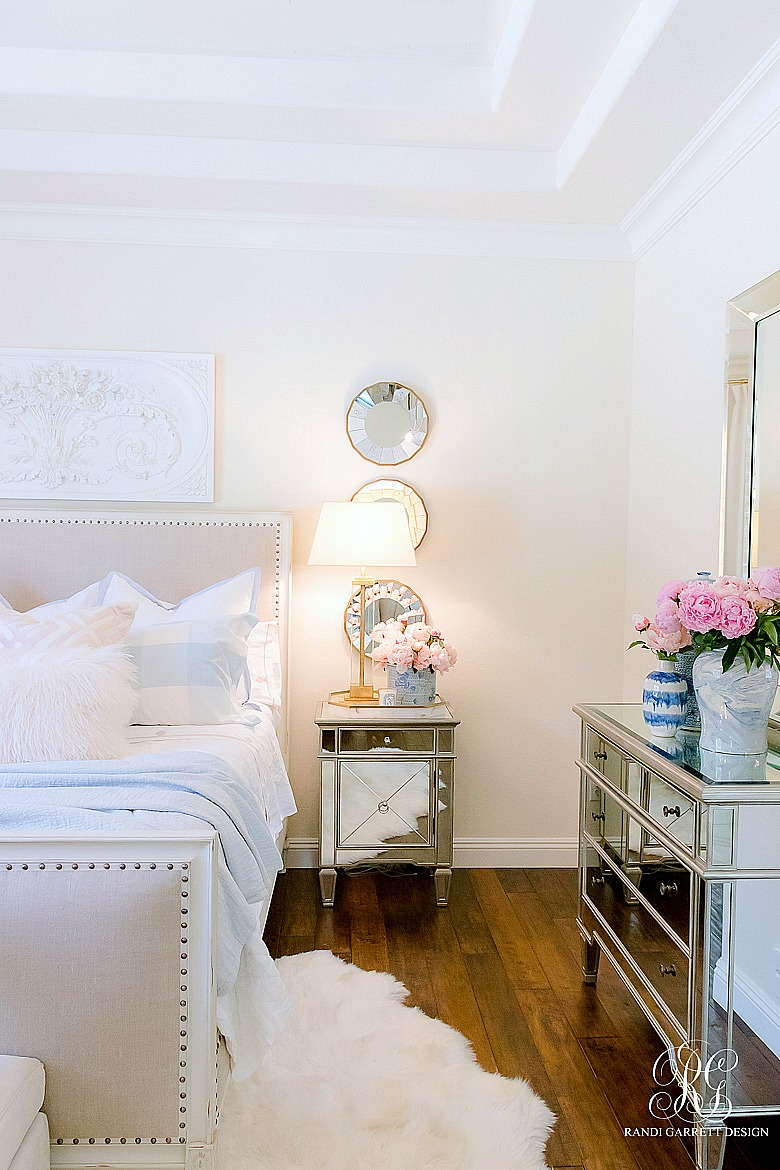 mirrored furniture - glam pink and blue bedroom styled for summer