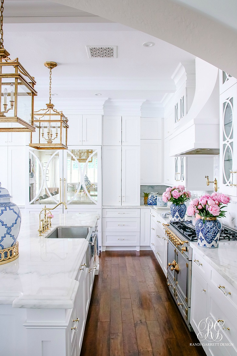 white kitchen with marble countertops - guide to marble