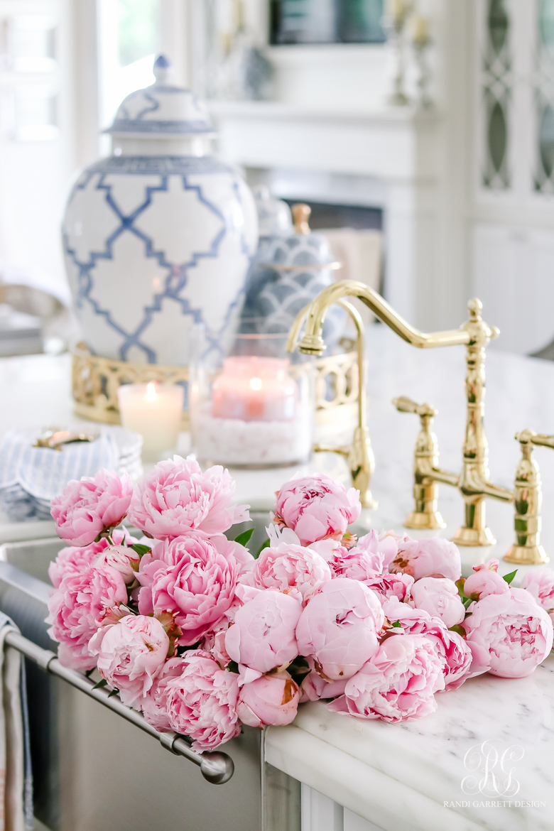 elegant kitchen with pink peonies in the sink