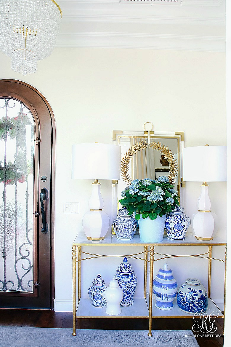 summer entryway - blue and white ginger jars - gold and white table