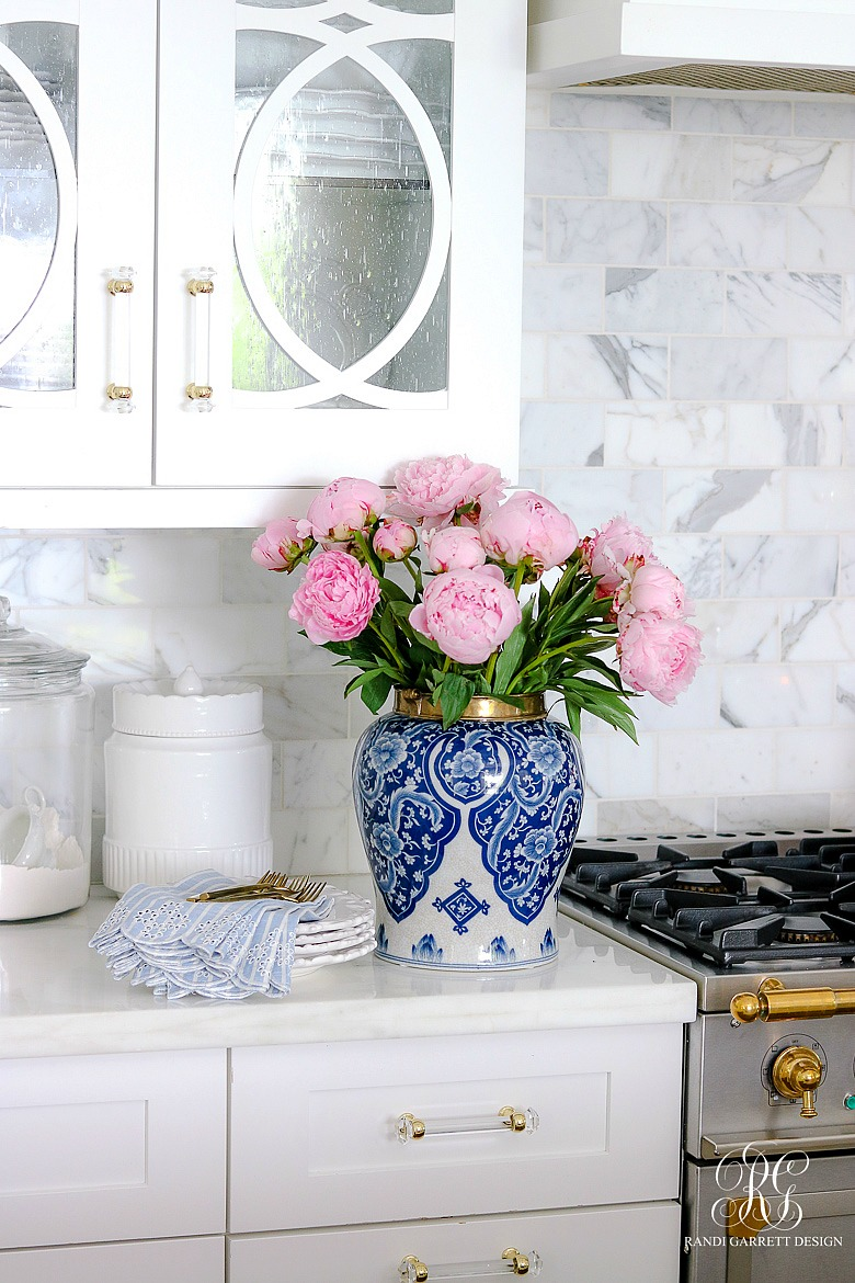blue and white ginger jar with pink peonies - summer decor ideas