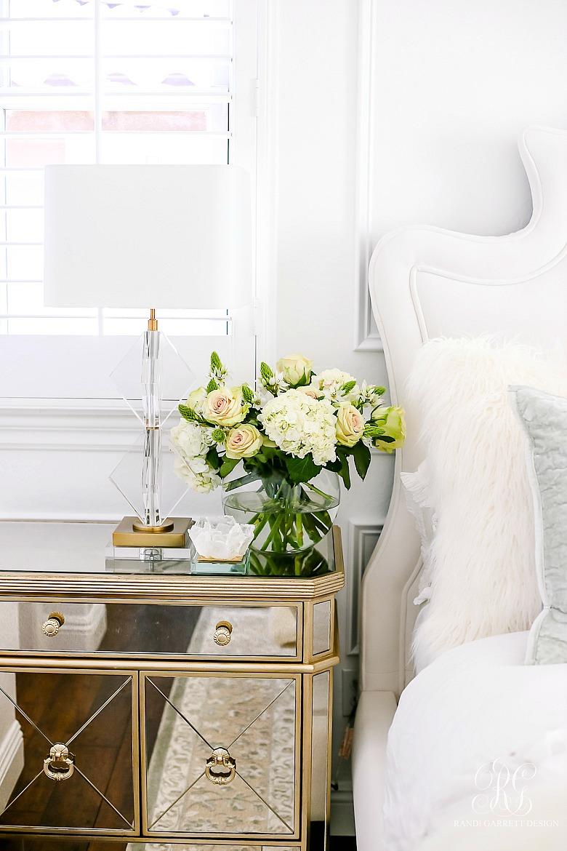 mirrored nightstands with rose and hydrangea arrangement