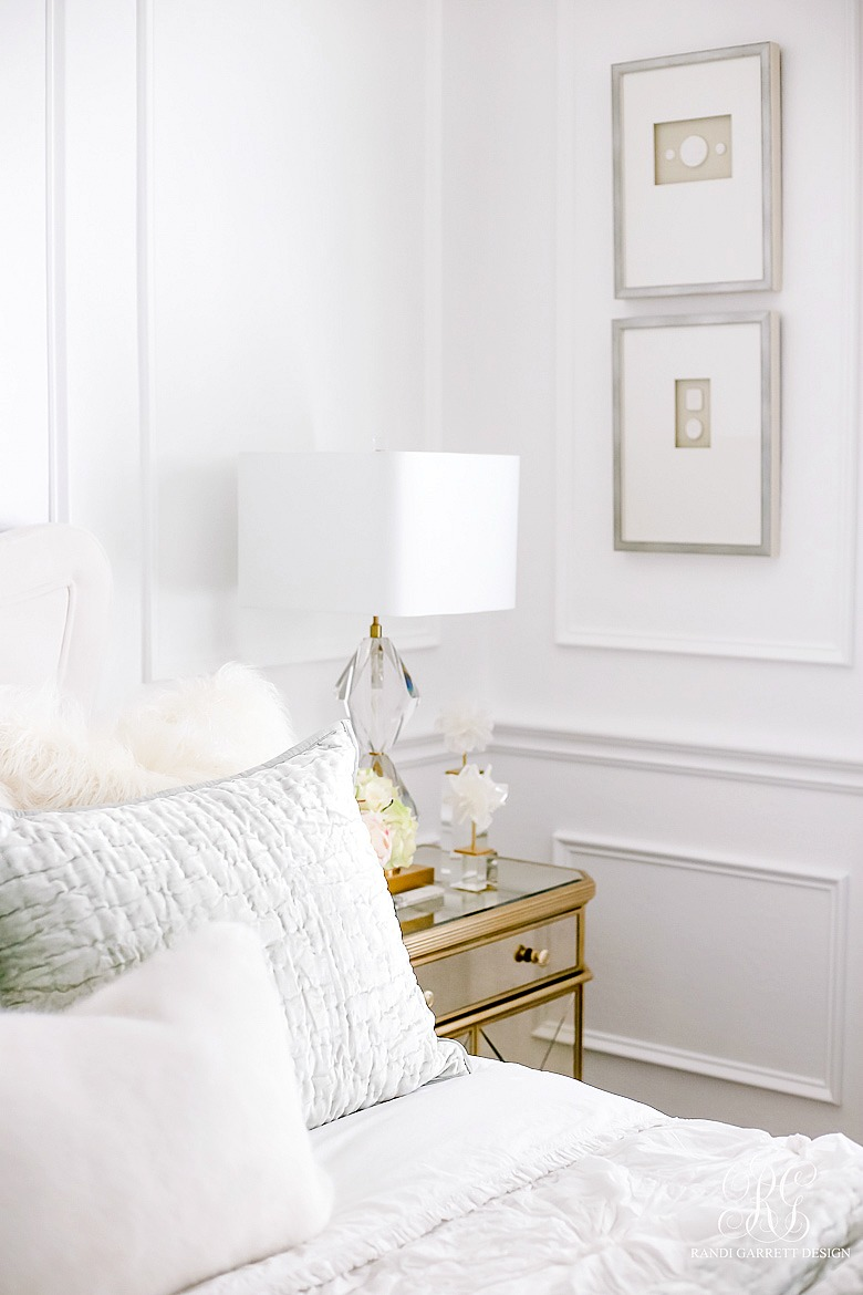 Glam bedroom with mirrored nightstands and lux finishings
