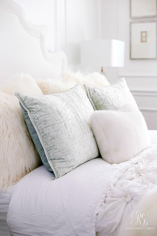 luxe guest bedroom - velvet bedding - fur pillows