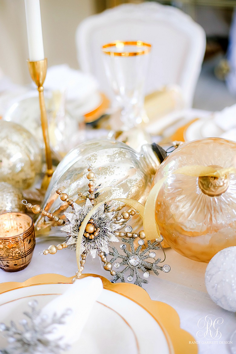 3 Tips to Set a Magical Silver and Gold Christmas Table - ornament table centerpiece