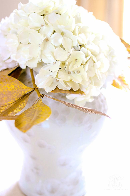white hydrangea arrangement in white temple jar