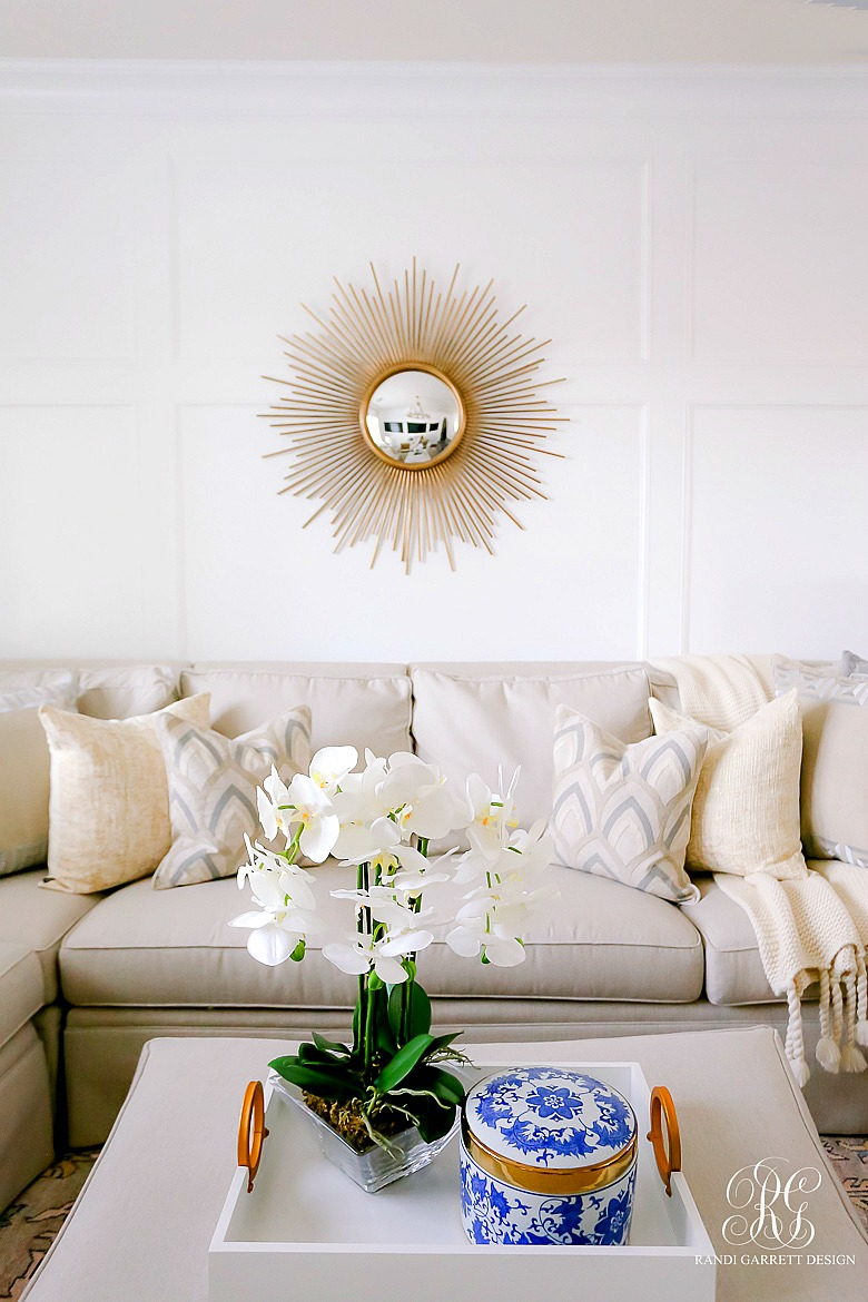 Simple Spring Decor Ideas for your Family Room - sunburst mirror - faux orchids
