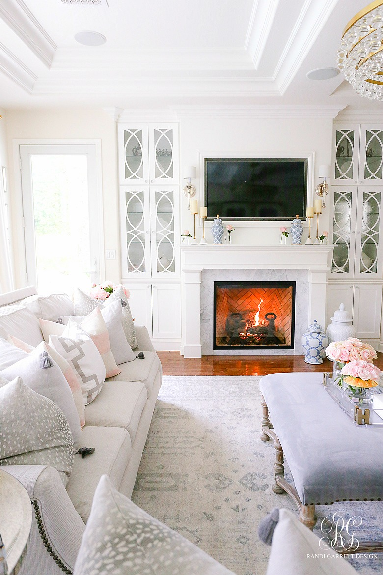 white fireplace with builtin bookcase - family room decor