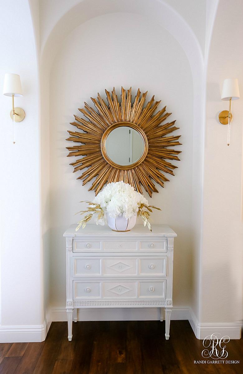 sunburst mirror gray chest hydrangea arrangment