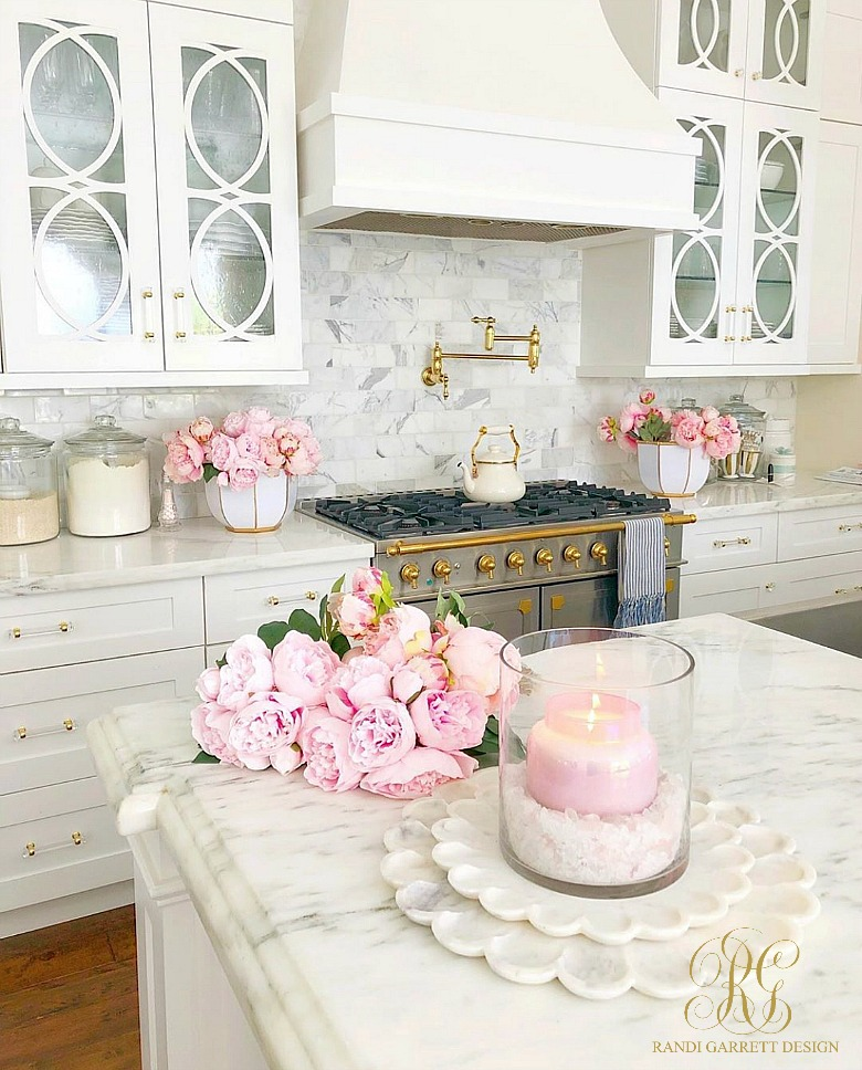 white kitchen marble countertops pink peonies