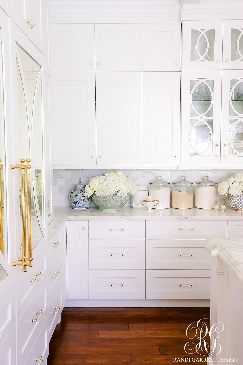 white kitchen cabinets gold accents