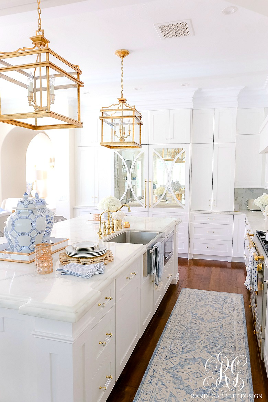 white kitchen blue gold accents