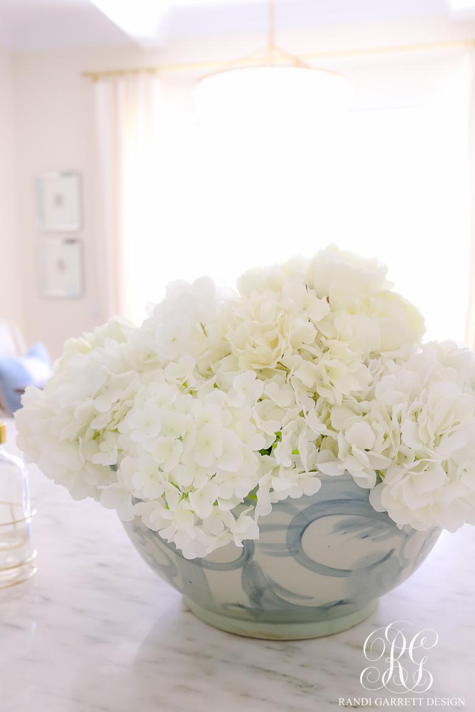 white hydrangea arrangement blue white bowl