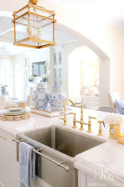 white kitchen gold faucet