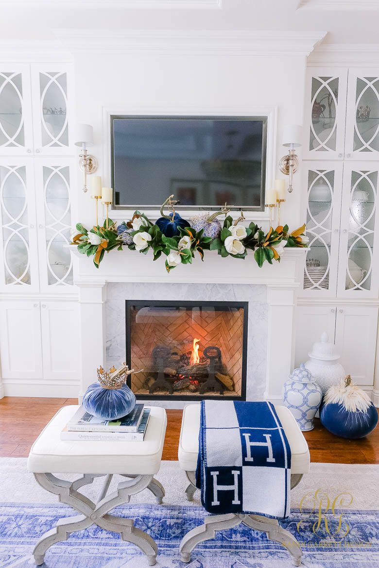 white fireplace styled for fall