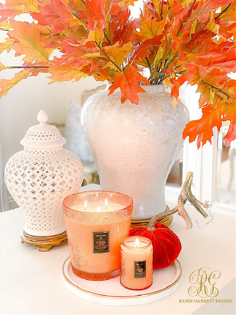 white ginger jars fall leaves fall candle