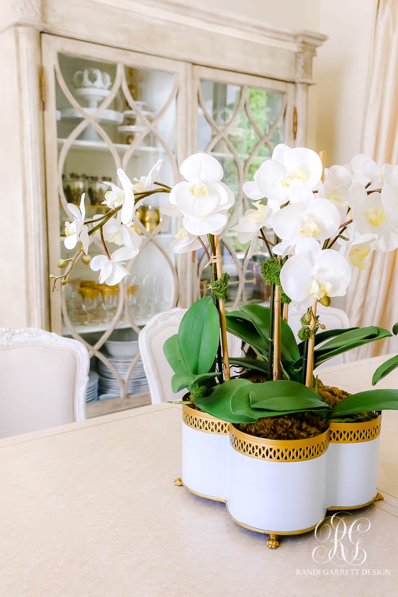 faux orchid in cache pot